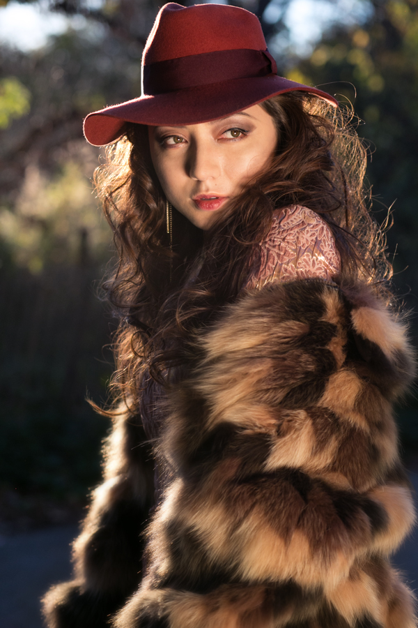red hat, fur, model photography, sun light, natural light, magic hour, fashion photography Amsterdam, fashion photographer