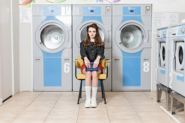waiting, laundry, washing machine, model, fashion photography, on-location photography, storytelling