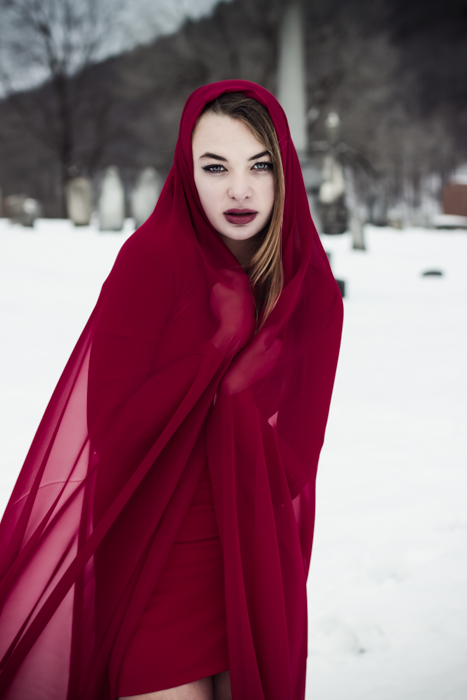 Fine art photography beautiful girl in the snow with red scarf